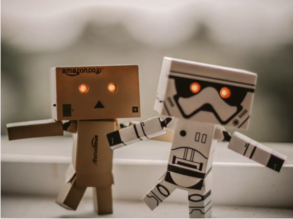 Two toy robots walking together